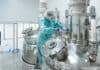 Pharmaceutical technician in sterile environment at pharmacy industry
