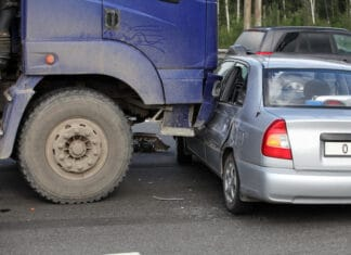 collision of the truck and car on a busy road