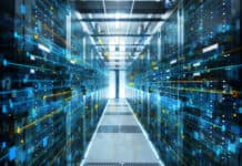 Adobe Stock royalty-free image #200146313, 'Shot of Corridor in Working Data Center Full of Rack Servers and Supercomputers with Internet connection Visualisation Projection.' uploaded by Gorodenkoff, standard license purchased from https://stock.adobe.com/images/download/200146313; file retrieved on May 9th, 2019. License details available at https://stock.adobe.com/license-terms - image is licensed under the Adobe Stock Standard License