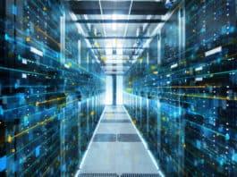 Adobe Stock royalty-free image #200146313, 'Shot of Corridor in Working Data Center Full of Rack Servers and Supercomputers with Internet connection Visualisation Projection.' uploaded by Gorodenkoff, standard license purchased from https://stock.adobe.comhttps://www.healthcarebusinesstoday.com/images/download/200146313; file retrieved on May 9th, 2019. License details available at https://stock.adobe.com/license-terms - image is licensed under the Adobe Stock Standard License