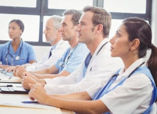 Medical team listening in conference room in hospital