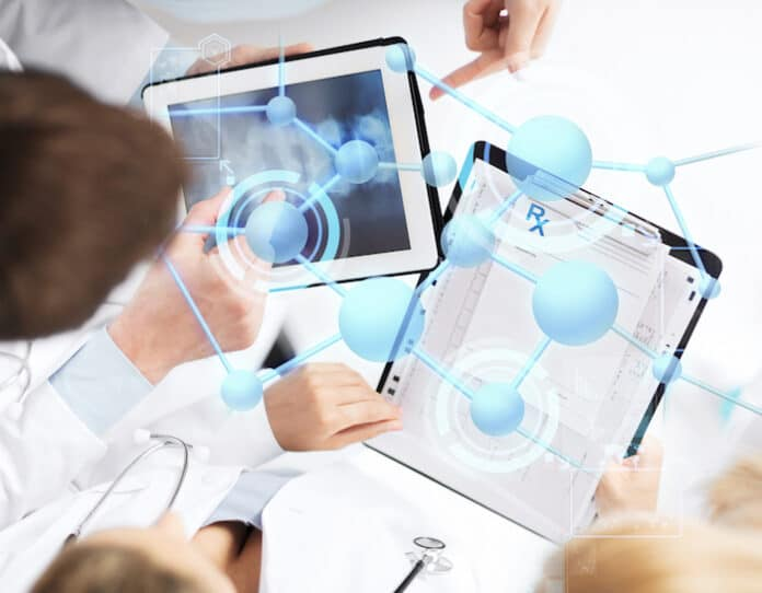 healthcare, technology, medicine and people concept - group of doctors with tablet pc, clipboard and molecular projection