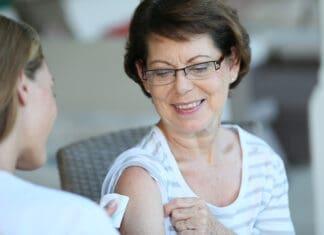 Senior woman receiving covid vaccine
